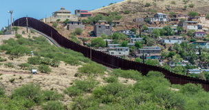 Border fence separating United States and Mexico. Looking across the border fence from Nogales Arizona into Mexico Stock Images