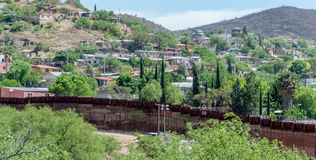 The border fence separating the United States and Mexico. Looking across the border fence from Nogales Arizona into Mexico Royalty Free Stock Images