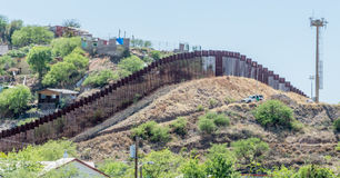 The border fence separating the United States and Mexico at Nogales. Looking across the border fence from Nogales Arizona into Mexico Stock Photography