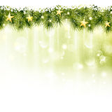 Border of fir twigs with golden stars. Golden stars in a border of fir twigs on a soft golden green background with blurry lights, light effects and snowfall Stock Image
