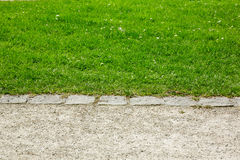 Border between footpath and lawn Royalty Free Stock Image