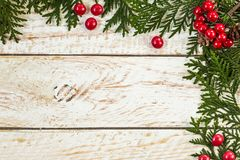 Frame from christmas tree branches with pine cones. Border, frame from christmas tree branches with pine cones and holly berries Royalty Free Stock Photos