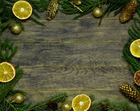 Border, frame from Christmas tree fir branches, gold pine cones