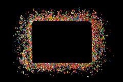 Border frame of colorful sprinkles on a black background with co stock photos