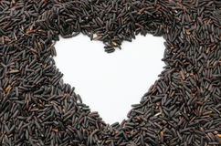 Border frame heart of rice berry in heart shape Stock Photos
