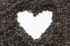 Border frame heart of rice berry in heart shape. Border frame heart of rice berry in white heart shape Stock Photos