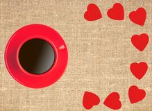 Border frame of red hearts and coffee cup on sack canvas Stock Image