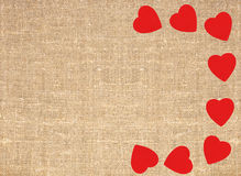 Border frame of red hearts on sack canvas burlap background text Royalty Free Stock Image