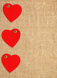 Border frame of red hearts on sack canvas Royalty Free Stock Images