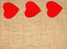 Border frame of red hearts on sack canvas burlap background Royalty Free Stock Photo