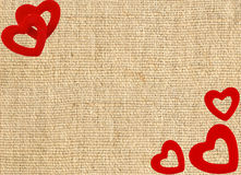 Border frame of red hearts on sack canvas burlap Royalty Free Stock Photography