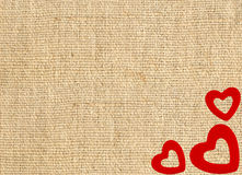 Border frame of red hearts on sack canvas burlap Royalty Free Stock Images