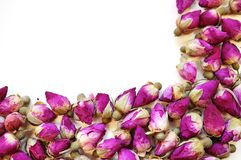 Border frame of romantic dried pink rose buds Royalty Free Stock Photos