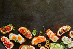Border of fresh canapes with copy space for menu Royalty Free Stock Photos