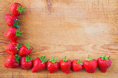 Border from fresh strawberries with copy space Royalty Free Stock Photos