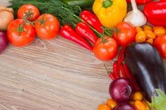 Border of fresh vegetables on table Stock Image