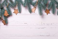 Border from fur tree  branches  and simple wooden toys. On  wooden background. Decorative christmas composition. Top  view. Place for text Royalty Free Stock Images