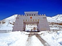 Border gate at Khunjerab Pass, Pakistan, China. The Khunjerab Pass, with an elevation of 5,000 metres or 16,000 feet, is a high mountain pass in the Karakoram stock photography