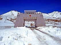 Border gate at Khunjerab Pass, Pakistan, China. The Khunjerab Pass, with an elevation of 5,000 metres or 16,000 feet, is a high mountain pass in the Karakoram royalty free stock photography