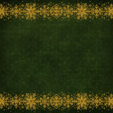 Border from gold snowflakes on a green vintage background Stock Image