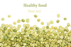 Border of green dry purified peas closeup with copy space on white background. Stock Photos