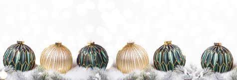 Border from green and golden balls and fir tree branches with bokeh lights stock photos