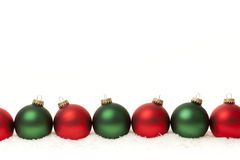 Border of green and red Christmas balls Royalty Free Stock Photos