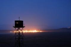 Border guard tower at night. A border guard tower at night with barbwires royalty free stock photos