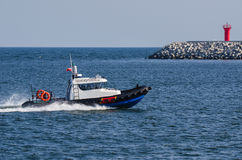 BORDER GUARDS - MOTORBOAT AT THE ROAD Royalty Free Stock Photography