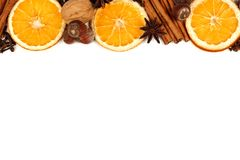 Border of holiday spices and baking ingredients over white Stock Photography