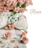 Border image with many pink roses and stuffed heart on white. Border image with many pink roses and heart on white. Space for your text. Design for an stock image