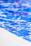 Border of indoor pool with mosaic blue and white tiles Royalty Free Stock Photography