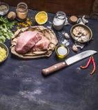 Border Ingredients for cooking concept Turkey meat on a paper for a steak knife grated lemon herbs garlic pepper salt  on rustik w Stock Image