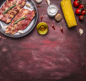 Border Ingredients for cooking raw Meat with bones for soup or broth with with herbs, cherry tomatoes, oil, corn, spices on wooden. Border Ingredients cooking Royalty Free Stock Image