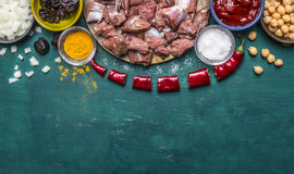Border with ingredients for the soup of lamb onions prunes hot red pepper seasoning tomato paste on green wooden rustic background. Border ingredients the soup royalty free stock photos