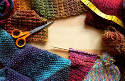 Border of knitting, wool, craft scissors and tape measure Royalty Free Stock Photos