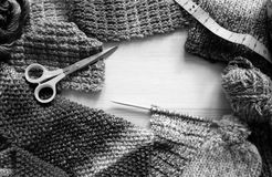 Border of knitting, wool, craft scissors and tape measure Stock Photo