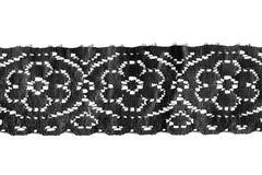 Border lace. Black vintage border lace isolated over white royalty free stock photo