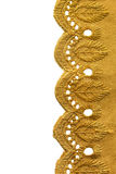 Border lace. Golden embroidered border lace on white background stock photography