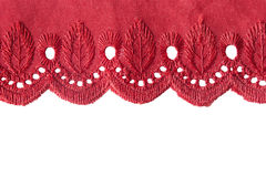 Border lace. Red embroidered border lace on white background royalty free stock photo