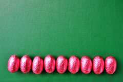 Border Line with Chocolate Eggs Easter. Border frame line with pink chocolate eggs Royalty Free Stock Image