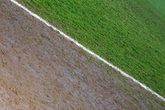 Border line of a football field photographed on a rainy day Stock Image
