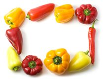 Border made of different peppers isolated Stock Photo