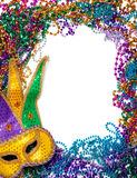 Border made of mardi gras bead and mask on white royalty free stock photos
