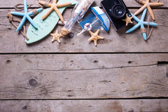 Border from marine items and old camera on  vintage wooden backg Royalty Free Stock Image