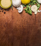 Border with mushrooms couscous with lemon grass and chopped garlic autumn fruit and vegetables  rustic wooden background top vie Royalty Free Stock Photos