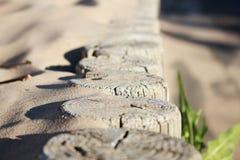 The border near the sand beach. The border near the sand beach on the sea Stock Photography