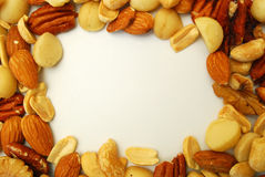 Border of nuts. Border of various nuts on a white background Royalty Free Stock Photos