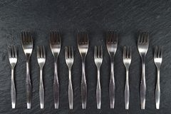 Border Of Forks On Slate Stock Photo