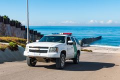 Border Patrol Vehicle Near Pacific Ocean at International Border. SAN DIEGO, CALIFORNIA - NOVEMBER 4, 2017: A Border Patrol vehicle drives near the international royalty free stock photography
